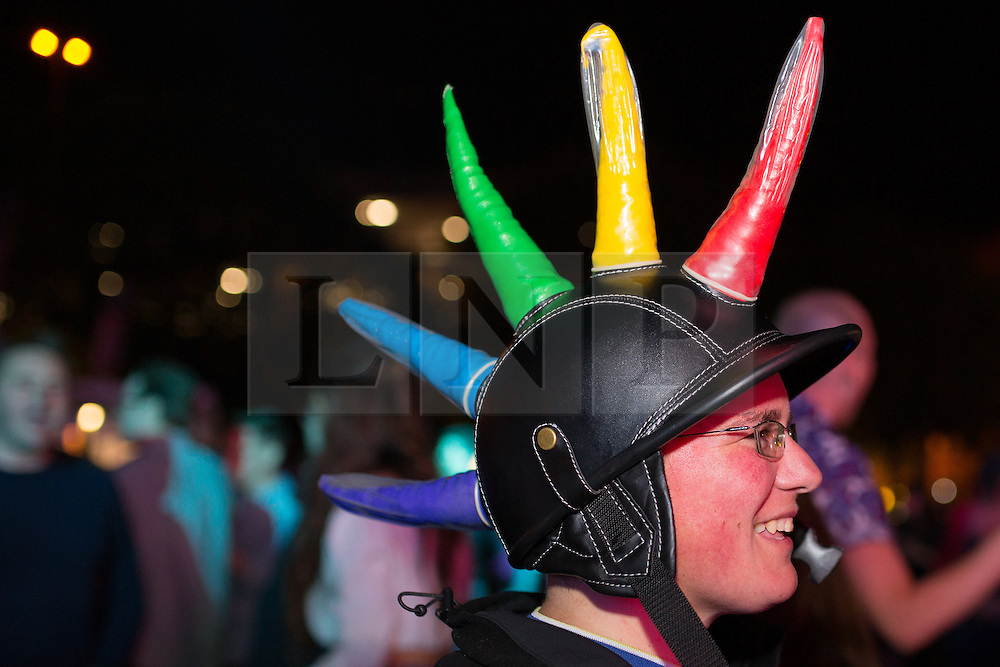 "© Licensed to London News Pictures . 22/08/2014 .  Manchester , UK . Interesting head wear on display . Manchester Pride "" Big Weekend "" in Manchester's "" Gay Village "" today ( 22nd August 2014 ) . Photo credit : Joel Goodman/LNP"