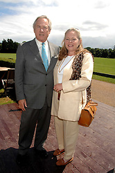 NICHOLAS & ANNIE COLQUOHOUN-DENVERS at a charity polo match organised by Jaeger Le Coultre at Ham Polo Club, Richmond, Surrey on 29th June 2007.<br />