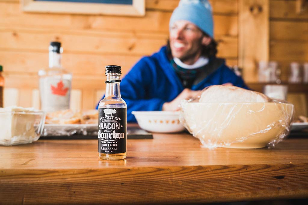 Bacon goes well with everything. Right? Unfinshed bottle of bacon flavored bourbon at the Burnie Glacier Chalet, Howson Range, BC.