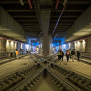 December 12, 2016 - New York, NY :  Train tracks crisscross as they wind through the Second Avenue subway tunnel just south of the 96th Street station. After years of delays, the new subway line is preparing to welcome its first straphangers. The governor, seen in brown jacket at right, visited the soon-to-open second avenue subway project on Monday morning with this photographer and New York Times reporter Emma G. Fitzsimmons, at far right.  CREDIT: Karsten Moran for The New York Times