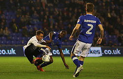 Ricky Miller of Peterborough United tangles with Ousmane Fane of Oldham Athletic - Mandatory by-line: Joe Dent/JMP - 26/09/2017 - FOOTBALL - Sportsdirect.com Park - Oldham, England - Oldham Athletic v Peterborough United - Sky Bet League One
