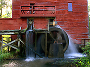 A historic mill and waterwheel continue to churn away as they have for countless years.