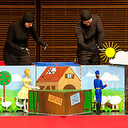 May 5, 2012 - New York, NY : From left, puppeteers Ursula Winzer, Vladimir Fediakov, and Philippe Nicolas Brunner of the Salzburg Marionette Theater perform Claude Debussy's 'La boîte à joujoux (The Toy Box) (1913),' featuring pianist András Schiff, not pictured, at Zankel Hall on Saturday evening. CREDIT: Karsten Moran for The New York Times