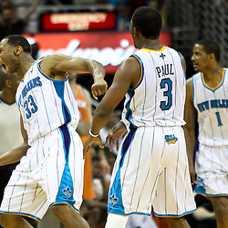 April 8, 2011; New Orleans, LA, USA; New Orleans Hornets shooting guard Willie Green (33) celebrates with point guard Chris Paul (3) during the fourth quarter against the Phoenix Suns at the New Orleans Arena. The Hornets defeated the Suns 109-97.   Mandatory Credit: Derick E. Hingle