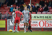 Grimsby Towns Kayden Jackson receives a yellow card during the EFL Sky Bet League 2 match between Crawley Town and Grimsby Town FC at the Checkatrade.com Stadium, Crawley, England on 26 November 2016. Photo by Jarrod Moore.