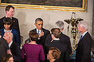 President Barack Obama gives a thumbs up at the Inaugural Luncheon in Statuary Hall at the U.S. Capitol on Monday, January 21, 2013 in Washington, DC.