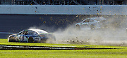 Jimmie Johnson (48) spins out in the infield during the NASCAR Cup Series auto race at Kansas Speedway in Kansas City, Kan., Sunday, Oct. 22, 2017. (AP Photo/Colin E. Braley)