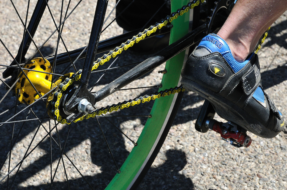 Green bicycle rim and yellow chain seen during chain, Cyclovia Tucson 2011. Bike-tography by Martha Retallick.