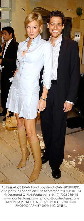 Actress ALICE EVANS and boyfriend ION GUFFUD at a party to celebrate the launch of Jimmy Choo New Concept at Harvey Nichols, Knightsbridge on 10th September 2002.