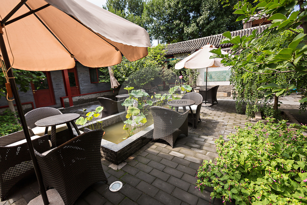 Interior courtyard of the Cote Cour Hotel, a restored traditional Chinese style courtyard home known as a siheyuan in Beijing, China