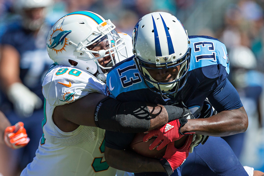 NASHVILLE, TN - OCTOBER 18:  Kendall Wright #13 of the Tennessee Titans is tackled by Earl Mitchell #90 of the Miami Dolphins at LP Field on October 18, 2015 in Nashville, Tennessee.  The Dolphins defeated the Titans 38-10.  (Photo by Wesley Hitt/Getty Images) *** Local Caption *** Kendall Wright; Earl Mitchell