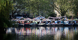 © Licensed to London News Pictures. 06/05/2018. London, UK. Boats covered in colourful bunting at day two of the Canalway Cavalcade festival takes place in Little Venice, West London on Sunday,  May 6th 2018. Inland Waterways Association's annual gathering of canal boats brings around 130 decorated boats together in Little Venice's canals on May bank holiday weekend. Photo credit: Ben Cawthra/LNP