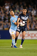 Melbourne Victory midfielder Terry Antonis (8) controls the ball away from Melbourne City midfielder Luke Brattan (26) at the Hyundai A-League Round 1 soccer match between Melbourne Victory and Melbourne City FC at Marvel Stadium in Melbourne.