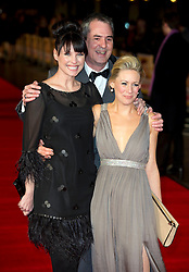 Neil Morrissey (C) and Kellie Shirley (R) arrives for the Run For Your Wife - UK film premiere Odeon -Leicester Sq- London Brit comedy about a happily married man - with two wives, Tuesday  February 5, 2013. Photo: Andrew Parsons / i-Images