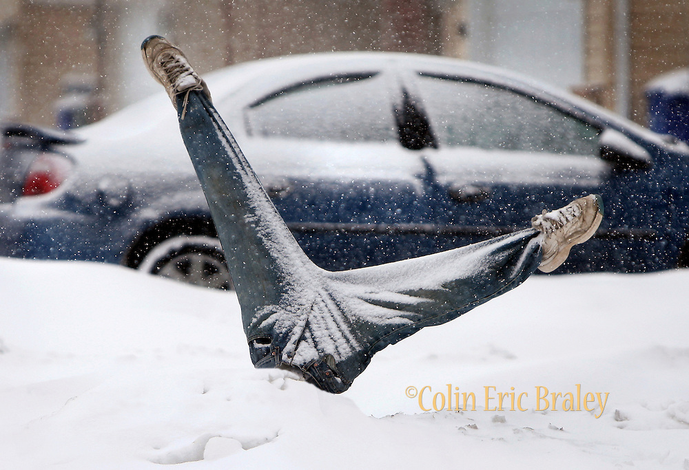 Poles covered with jeans and a pair of shoes at a home in the 700 block of Century Drive in Ogden, makes for a humorous statement about our winter thus far. Residents in the top of Utah may feel the same way as  more of the white stuff is expected to hit the area. PHOTO BY COLIN BRALEY