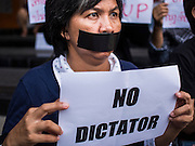 20 MAY 2014 - BANGKOK, THAILAND: A Thai woman with tape over her mouth protests the Thai army declaration of martial law. The protestors put tape over their mouths to dramatize the alleged loss of free speech under martial law. About 200 Thais gathered at the Bangkok Art and Culture Centre in central Bangkok to protest the army's decision to impose martial law.   PHOTO BY JACK KURTZ
