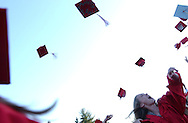 Graduates toss their caps at Wellesley H.S.'s commencement ceremony.
