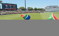 Pretoria 26-12-18. The 1st of three 5 day cricket Tests, South Africa vs Pakistan at SuperSport Park, Centurion. Day 1. Jaime(9) and her sister Jeanli Theys(6) from Primrose, Johannesburg waves  South African flags in the heat of the day as temperatures soared to around 35deg Celcius.<br /> Picture: Karen Sandison/African News Agency(ANA)<br /> <br /> Picture: Karen Sandison/African News Agency(ANA)