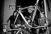 After the bikes are cleaned, they are passed to a third mechanic, who re-assembles and prepares the bikes for overnight storage and the next day's stage.