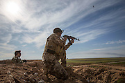 KURDISTAN, NORTHERN IRAQ, Dokuk.<br /> Qalubna Ma'Kum Feature:<br /> Qalubna Ma'kum (meaning &quot;Our hearts are With You&quot;) are a group of foreign volunteer fighters who have joined up with the Peshmerga in Kurdistan to help with the battle against Daesh, also known as ISIS. <br /> <br /> Pictured: French volunteer and co-founder of Qalubna Ma'kum Francis Cuvelier (left) trains a new volunteer , also from France.