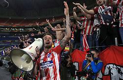 Atletico Madrid's Saul Niguez celebrates with a megaphone after winning the UEFA Europa League final at Parc Olympique Lyonnais, Lyon.