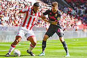 Leeds United midfielder Mateusz Klich (43) and Stoke City defender Cameron Carter-Vickers (12) during the EFL Sky Bet Championship match between Stoke City and Leeds United at the Bet365 Stadium, Stoke-on-Trent, England on 24 August 2019.