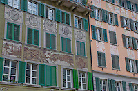 Details of painted building facades in the old town of Lucerne, Switzerland.