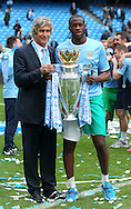 Yaya Toure and manager Manuel Pellegrini of Manchester City celebrate with the Barclays Premier League trophy at the Etihad Stadium, Manchester<br /> Picture by John Rainford/Focus Images Ltd +44 7506 538356<br /> 11/05/2014