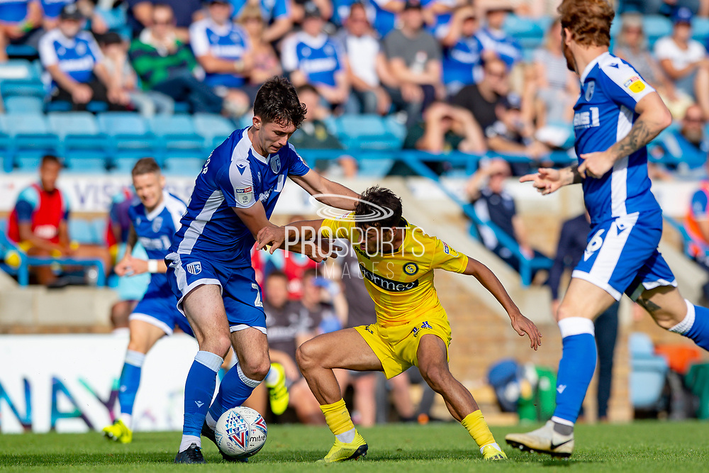 Gillingham FC defender Thomas O'Connor  (24) and Wycombe Wanderers forward Scott Kashket (11) during the EFL Sky Bet League 1 match between Gillingham and Wycombe Wanderers at the MEMS Priestfield Stadium, Gillingham, England on 14 September 2019.
