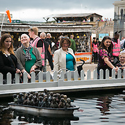 Migrants at sea - for 1 pund visitors can stear the boats with migrants around the pond. Art work by Banksy. On the first day the show is open only a thousand locals who won free ticket gets an advanced entry to the show.Dismaland, a bemusement park set up by artist Banksy show casing more hand 40 artists. The bemusement park is set in a former lido in Weston Super-Mare.After much secrecy the show opened to a small number of locals from Weston Super-Mare Friday and fully to the public Saturday Aug 22.