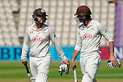 Surrey's Gareth Batty and Surrey's Ben Foakes walk to the pavilion for the tea interval after the pair both score centuries during the Specsavers County Champ Div 1 match between Hampshire County Cricket Club and Surrey County Cricket Club at the Ageas Bowl, Southampton, United Kingdom on 18 July 2016. Photo by Graham Hunt.