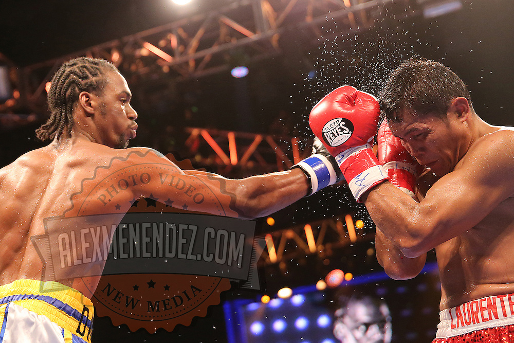 WINTER PARK, FL - AUGUST 02: John Jackson (L) fights against Dennis Laurente during the Premier Boxing Champions on Bounce TV boxing match at Full Sail University - Ebbs Auditorium on August 2, 2015 in Winter Park, Florida.  Jackson won the bout. (Photo by Alex Menendez/Getty Images) *** Local Caption *** John Jackson; Dennis Laurente