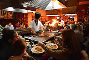 Hibachi Chef Maki Liang cooks over the grill for diners at K60 restaurant in Lake Grove, N.Y.