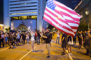 CHINA, Hong Kong: 16 August 2019 <br /> Thousands of protesters descend on to Chater Park this evening as demonstrators watch video messages of support from international supporters as well as live speakers. The American flag has been adopted as a sign of Freedom by some of the protesters. Demonstrators urged The UK this evening to declare that China has breached the 1984 Sino-British Joint Declaration, a binding international treaty.<br /> Rick Findler / Story Picture Agency