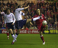 Photo. Glyn Thomas.<br /> Middlesbrough v Tottenham Hotspur.<br /> FA Barclaycard Premiership.<br /> Riverside Stadium, Middlesbrough. 09/03/2004.<br /> Middlesbrough's Bolo Zenden (R) battles for the ball with Stephen Carr (C) while Darren Anderton looks on.