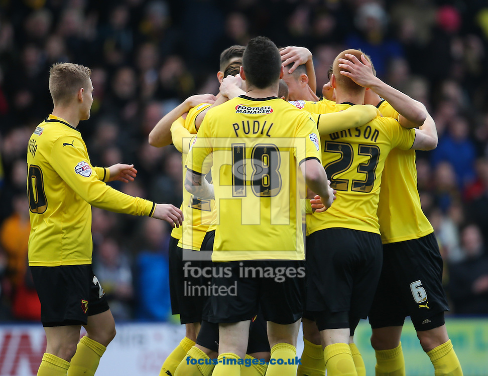 Ben Watson, (23), of Watford is mobbed by team-mates after opening the scoring against Reading during the Sky Bet Championship match at Vicarage Road, Watford<br /> Picture by John Rainford/Focus Images Ltd +44 7506 538356<br /> 14/03/2015