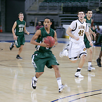 Panther Guard Jarrell Sample (5) quickly moves the ball downcourt agains Fort Zumwalt East.