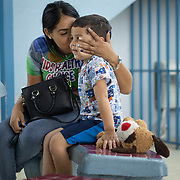 JULY 20, 2018---YABUCOA, PUERTO RICO----<br /> Shaina Ortega 26, kisses her son Keydiel Vasquez, 5, <br /> in the yard of the Marta Sanchez Alverio school he attends. <br /> (Photo by Angel Valentin/Freelance)