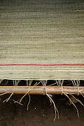 A jute mat on a loom on Binh Thanh Island, Vietnam.