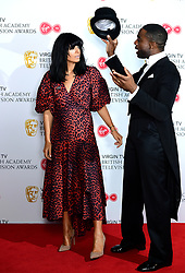 Claudia Winkleman and Ore Oduba in the press room at the Virgin TV British Academy Television Awards 2018 held at the Royal Festival Hall, Southbank Centre, London. PRESS ASSOCIATION Photo. Picture date: Sunday May 13, 2018. See PA story SHOWBIZ Bafta. Photo credit should read: Ian West/PA Wire