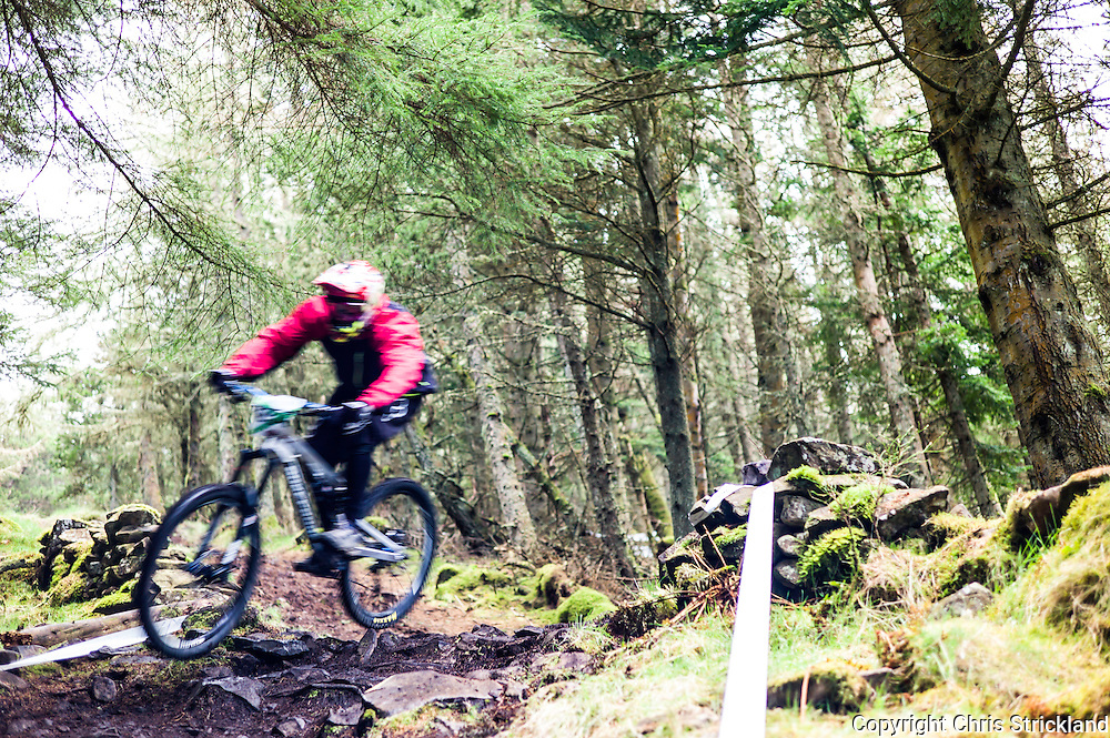 Innerleithen, Peebles, Scotland, UK. 24th April 2016. Mountain Bikers compete in the 2nd Round of the Scottish Downhill Association (SDA) series on the Innerleithen 7Stanes trails in the Tweed Valley.