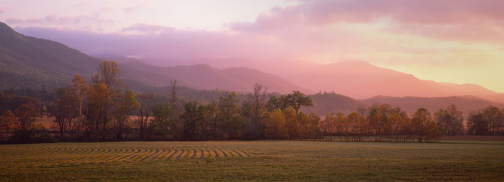 A typical dreamy sunrise over the fields of Cades Cove in fall