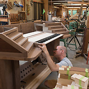 Tony Miscio at C. B. Fisk, Inc., Gloucester, MA, assembling a keyboard for a pipe organ.