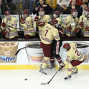 Torin Snyderman #17 of the Northeastern Huskies collides with Isaac MacLeod #7 of the Boston College Eagles during The Beanpot Championship Game at TD Garden on February 10, 2014 in Boston, Massachusetts. (Photo by Elan Kawesch)