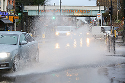 © Licensed to London News Pictures. 15/01/2020. London, UK. A car drives through a flood on Green Lanes in north London following heavy overnight rainfall. Photo credit: Dinendra Haria/LNP
