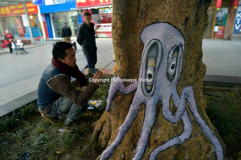 CHONGQING, CHINA - JANUARY 05: (CHINA OUT) P<br /> <br /> Art Students Paint Animals On Tree Trunks<br /> <br /> Cartoon animal drawings on the tree trunks at a pedestrian street on January 5, 2016 in Chongqing, China. Students from art school painted cartoon animal drawings on the tree trunks at Yangjiaping pedestrian street in Chongqing. <br /> &copy;Exclusivepix Media