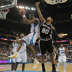 29 March 2009: New Orleans Hornets guard Rasual Butler (45) grabs a rebound over San Antonio Spurs center Drew Gooden (90) during a 90-86 victory by the New Orleans Hornets over Southwestern Division rivals the San Antonio Spurs at the New Orleans Arena in New Orleans, Louisiana.