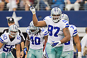 DALLAS, TX - SEPTEMBER 23:  Jason Hatcher #97 of the Dallas Cowboys celebrates after a big play against the Tampa Bay Buccaneers at Cowboys Stadium on September 23, 2012 in Dallas, Texas.  The Cowboys defeated the Buccaneers 16-10.  (Photo by Wesley Hitt/Getty Images) *** Local Caption *** Jason Hatcher