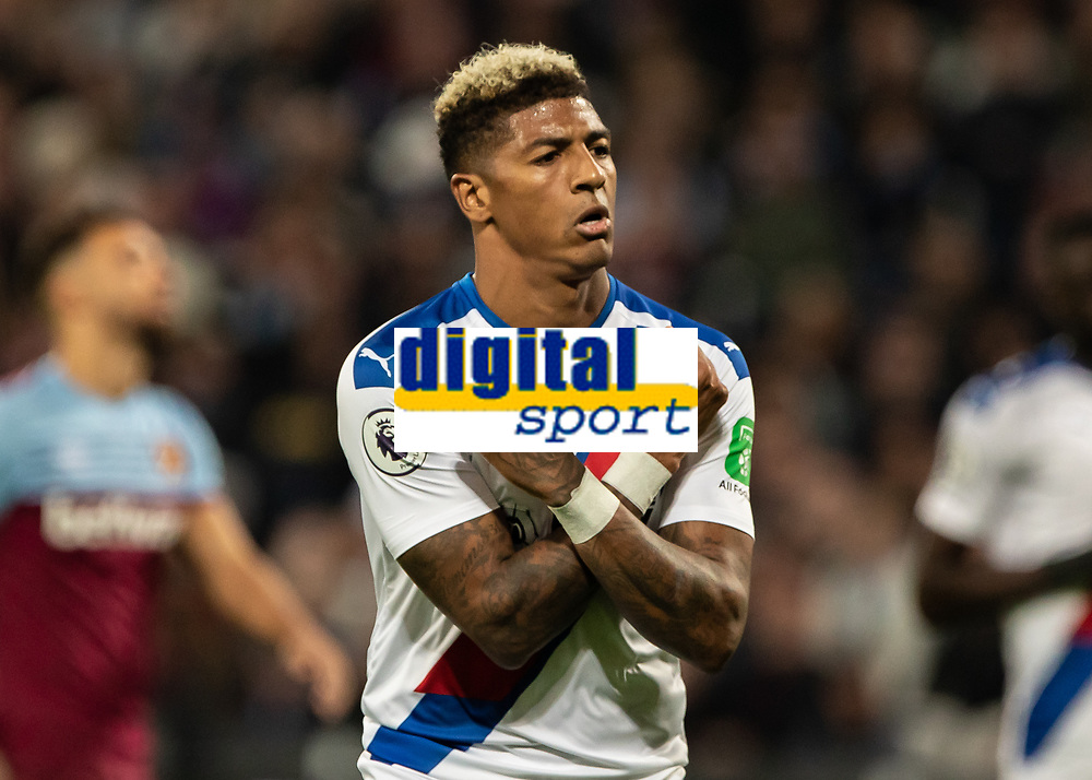Football - 2019 / 2020 Premier League - West Ham United vs. Crystal Palace <br /> <br /> Patrick van Aanholt (Crystal Palace) celebrates as he runs to the travelling supporters after scoring from the penalty spot at the London Stadium<br /> <br /> COLORSPORT/DANIEL BEARHAM