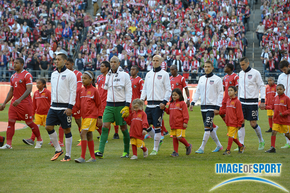 Jun 11, 2013; Seattle, WA, USA; United States players Clint Dempsey (8), Tim Howard, Michael Bradley (4), Fabrian Johnson (20) and Geoff Cameron (20) are accompanied onto the field by youngsters before the game against Panama in a FIFA World Cup Qualifier at CenturyLink Field. The United States defeated Panama 2-0.